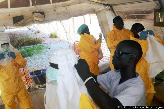 Members of MSF put on protective gear to deal with the Ebola virus. Photo: CELLOU BINANI/AFP/Getty Images